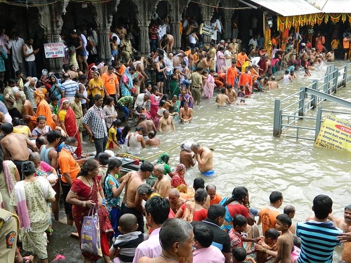 Devotees at sacred pool for Royal Dip, Trimbakeshwar, Nasik, India